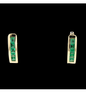 Yellow gold and emerald buckles