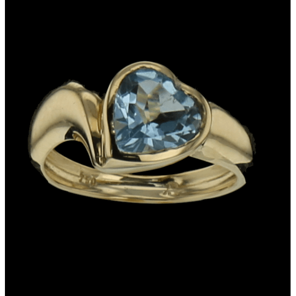 Ring in yellow gold heart topaz