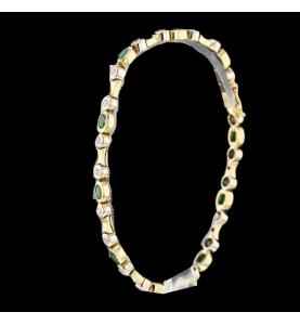 Bracelet or jaune émeraudes et diamants